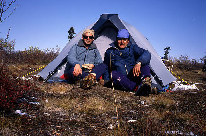 Frank Huber (right) and his son, Jeff, pose in front of their tent during a hunting trip