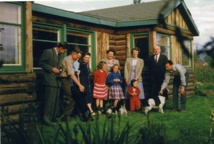 Group photo in front of Charles Sawyer Wilson's cabin. From Sleeper family papers.